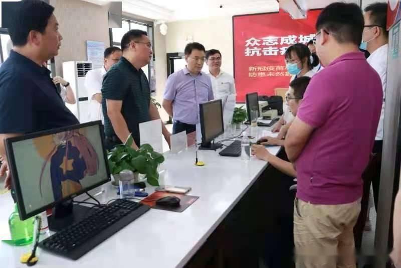 国家人社部社保中心主任贾怀斌等一行深入罗针镇调研城乡居民养老保险工作